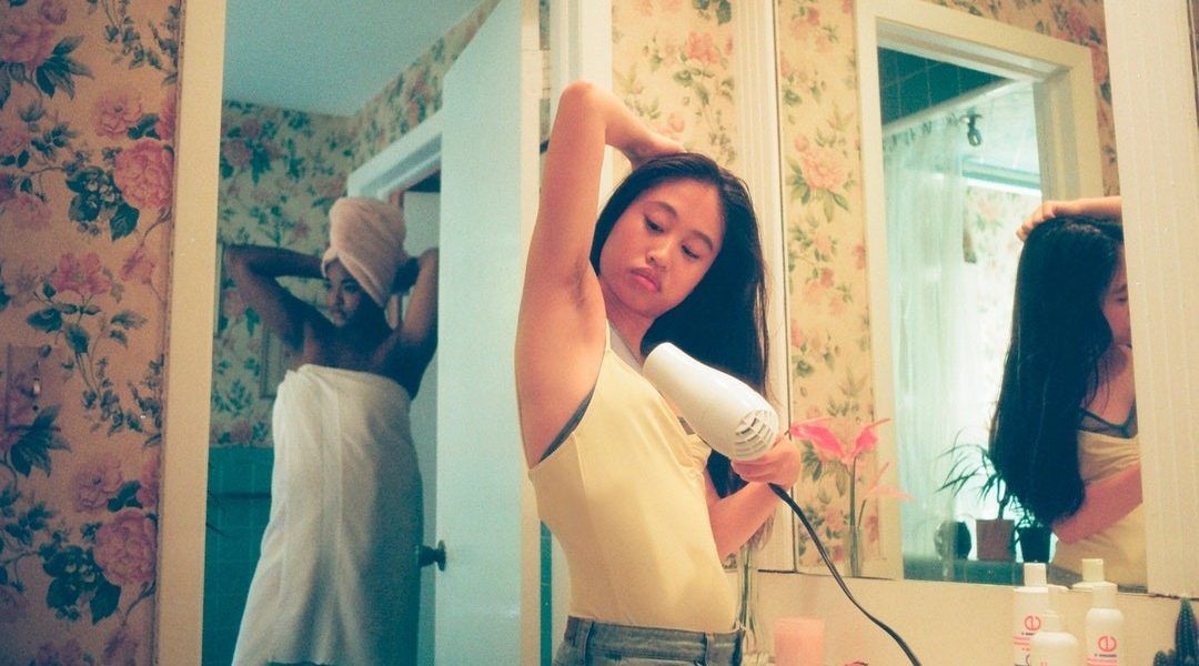 Woman Dealing with Excessive Underarm Sweating - miraDry Treatment in Utah by Revivology